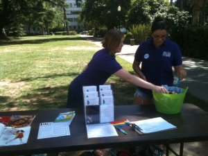 WRC staffers Rachel and Emily set up an info booth at Slut Walk Sacramento 2012, Sacramento's first Slut Walk!